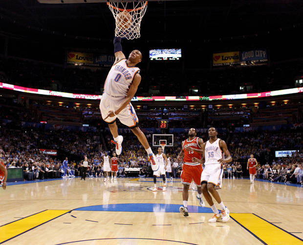 Oklahoma City's Russell Westbrook (0) dunks the ball during the NBA basketball game between the Oklahoma City Thunder and the Milwaukee Bucks at the Oklahoma City Arena, Wednesday, April 13, 2011. Photo by Bryan Terry, The Oklahoman