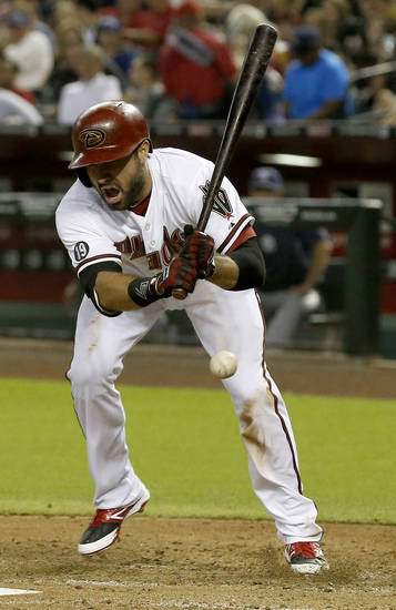 Arizona Diamondbacks' Adam Eaton shouts after being hit on the foot by a pitch from San Diego Padres' Tyson Ross during the fourth inning of a baseball game on Monday, Aug. 26, 2013, in Phoenix. (AP Photo/Ross D. Franklin)