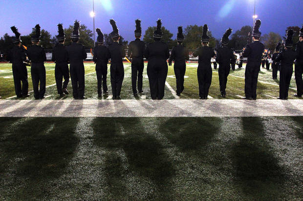 The Norman High School band takes the field before the Lawton - Norman High School football game at Harve Collins Field at Norman High School in Norman Friday night. PHOTO BY HUGH SCOTT FOR THE OKLAHOMAN ORG XMIT: KOD