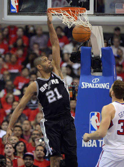 San Antonio Spurs center Tim Duncan dunks as Los Angeles Clippers forward Blake Griffin during the first half in Game 4 of an NBA basketball playoffs Western Conference semifinal, Sunday, May 20, 2012, in Los Angeles. (AP Photo/Mark J. Terrill)