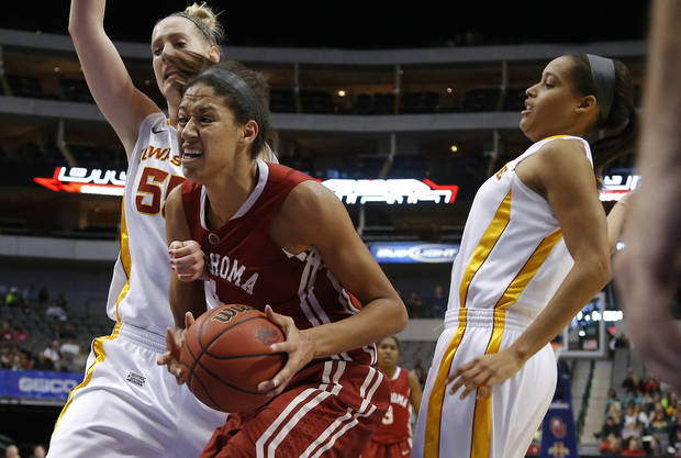 Oklahoma's Nicole Griffin (4) goes between Iowa State's Anna Prins (55) and Nikki Moody (4) during the Big 12 tournament women's college basketball game between the University of Oklahoma and Iowa State University at American Airlines Arena in Dallas, Sunday, March 10, 2012.  Oklahoma lost 79-60. Photo by Bryan Terry, The Oklahoman