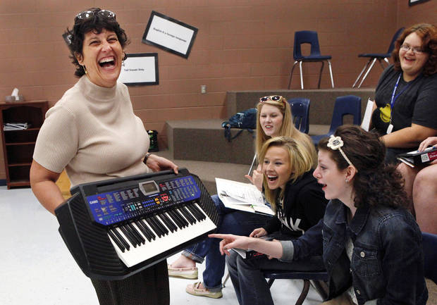 Bonnie Sneed, director of choirs at Choctaw High School, shows an electronic keyboard to members of one of her choral groups. She is seeking donations of keyboards from community residents for use by choir members. Photos by Jim Beckel, The Oklahoman