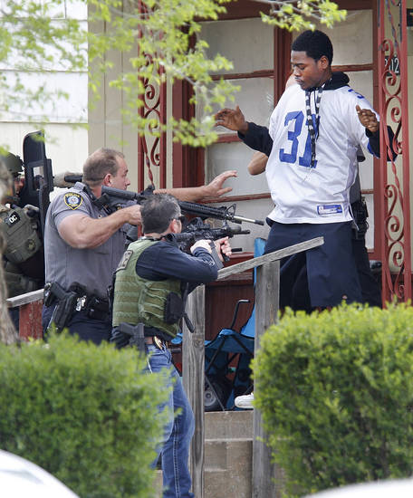 Oklahoma City Police and the FBI take a suspect into custody in connection to the robbery of MidFirst Bank in Oklahoma City , Friday April 12, 2013. The suspect was in a home at 3024 NE 16th street. Photo By Steve Gooch, The Oklahoman