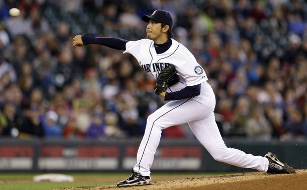 Seattle Mariners starting pitcher Hisashi Iwakuma throws against the Texas Rangers in the third inning in a baseball game on Sunday, May 26, 2013, in Seattle. (AP Photo/Elaine Thompson)