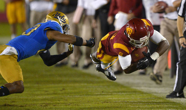 USC and UCLA lead the Pac-12 in non-conference scheduling, says Berry Tramel. (AP Photo/Mark J. Terrill)