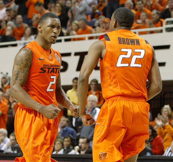 Oklahoma's Le'Bryan Nash (2) and Markel Brown (22) celebrate during an NCAA men's college basketball game between the Oklahoma State Cowboys (OSU) and the Tulsa Golden Hurricane (TU), at Gallagher-Iba Arena in Stillwater, Okla., Wednesday, Nov. 30, 2011. Photo by Bryan Terry, The Oklahoman