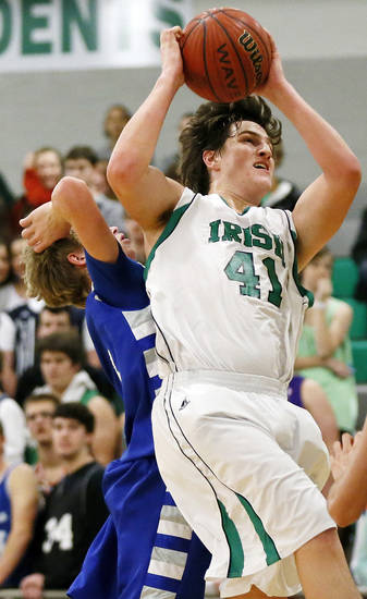 David Love (41) of Bishop McGuinness grabs a rebound in front of JD Honeycutt (5) of Guthrie during a game between Guthrie and Bishop McGuinness in the McGuinness Classic boys high school basketball tournament at Bishop McGuinness Catholic High School in Oklahoma City, Friday, Jan. 11, 2013. Photo by Nate Billings, The Oklahoman