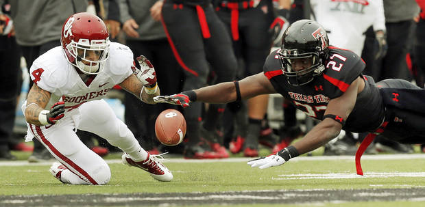 Oklahoma's Kenny Stills (4) tries to recover an OU fumble next toTexas Tech's Zach Winbush (27) in the third quarter during a college football game between the University of Oklahoma (OU) and Texas Tech University at Jones AT&T Stadium in Lubbock, Texas, Saturday, Oct. 6, 2012. Photo by Nate Billings, The Oklahoman