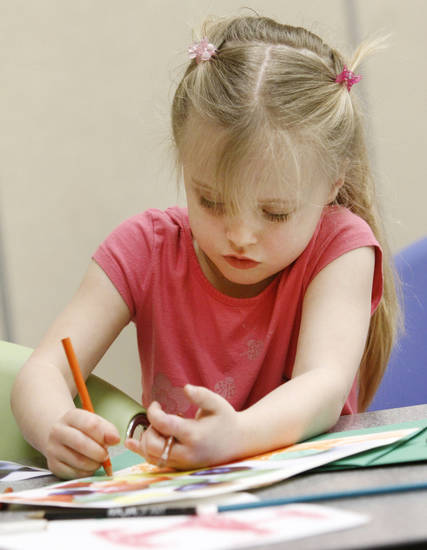 Hannah Wright, 5, works on a photo-realism art project during art camp at the Oklahoma City Museum of Art. A second week of spring break camp starts Tuesday. Photo By Steve Gooch, The Oklahoman <strong>Steve Gooch - The Oklahoman</strong>