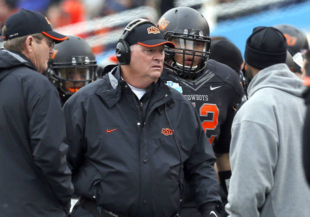 OSU Defensive Coordinator / Defensive Line Bill Young is pictured on the sidelines during the Heart of Dallas Bowl football game between the Oklahoma State University (OSU) and Purdue University at the Cotton Bowl in Dallas, Tuesday,Jan. 1, 2013. Photo by Sarah Phipps, The Oklahoman <strong>SARAH PHIPPS</strong>