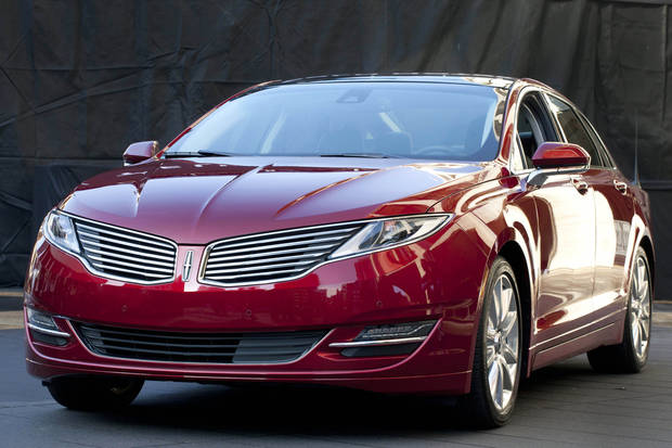 The Lincoln MKZ is shown at a media availability, Monday, Dec. 3, 2012 in New York. The MKZ will arrive at dealerships this month as the first of seven new or revamped Lincolns that will go on sale by 2015. (AP Photo/Mark Lennihan)