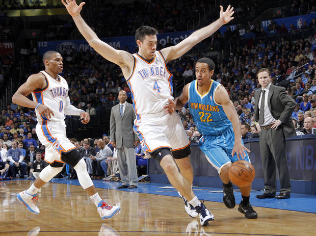 Oklahoma City Thunder's Nick Collison (4) defends on New Orleans Hornets' Brian Roberts (22) during the NBA basketball game between the Oklahoma CIty Thunder and the New Orleans Hornets at the Chesapeake Energy Arena on Wednesday, Dec. 12, 2012, in Oklahoma City, Okla.   Photo by Chris Landsberger, The Oklahoman