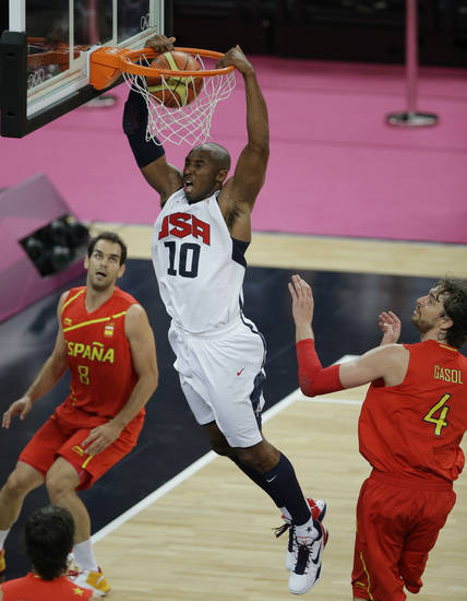 United States' Kobe Bryant dunks against Spain's Pau Gasol, right, and Jose Calderon during the men's gold medal basketball game at the 2012 Summer Olympics, Sunday, Aug. 12, 2012, in London. (AP Photo/Matt Slocum)
