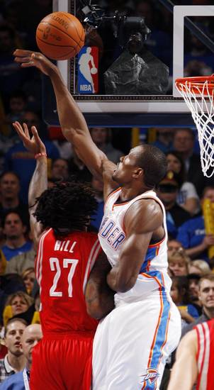 Oklahoma City's Serge Ibaka (9) blocks the shot of Houston's Jordan Hill (27) in the first quarter during the NBA basketball game between the Oklahoma City Thunder and the Houston Rockets at Chesapeake Energy Arena in Oklahoma City, Friday, Jan. 6, 2012. Photo by Nate Billings, The Oklahoman