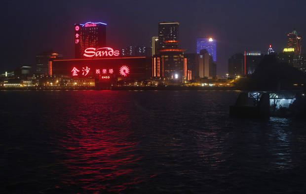In this Oct. 25, 2012 photo, Sands Casino complex is lit up in Macau. Hordes of Chinese high rollers flooding into Macau have turned the city into an Asian casino boomtown but they�re also posing a challenge for China�s next generation of leaders. (AP Photo/Vincent Yu)