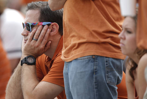 Texas fans look on in the fourth quarter of the 63-21 loss to Oklahoma during the Red River Rivalry college football game between the University of Oklahoma (OU) and the University of Texas (UT) at the Cotton Bowl in Dallas, Saturday, Oct. 13, 2012. Photo by Chris Landsberger, The Oklahoman