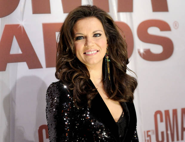 FILE - In this Nov. 9, 2011 file photo, singer Martina McBride arrives at the 45th Annual CMA Awards in Nashville. McBride will perform her new single, �Marry Me,� with Train lead singer Pat Monahan while a couple from New Jersey gets married on stage at the Academy of Country Music Awards Sunday April 1, 2012. (AP Photo/Evan Agostini, file)