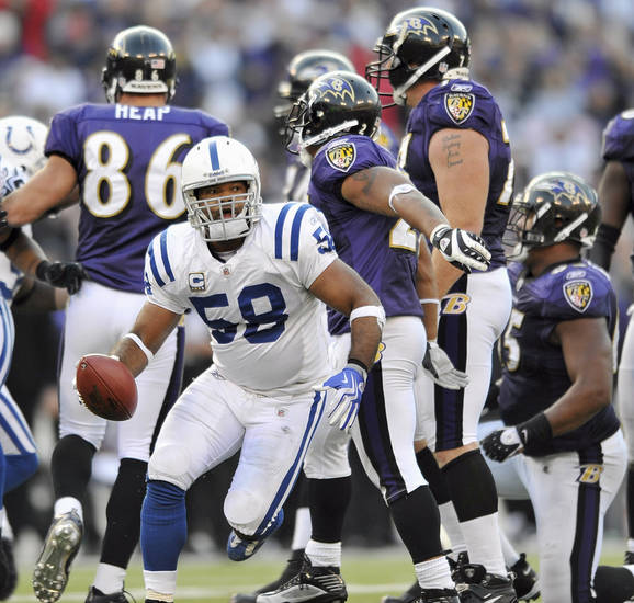 Indianapolis Colts linebacker Gary Brackett turns toward the bench holding ball after intercepting a pass by Baltimore Ravens quarterback Joe Flacco during the closing minutes of an NFL football game against the Baltimore Ravens, Sunday, Nov. 22, 2009 in Baltimore. The Colts won 17-15. (AP Photo/Gail Burton) ORG XMIT: BAF116