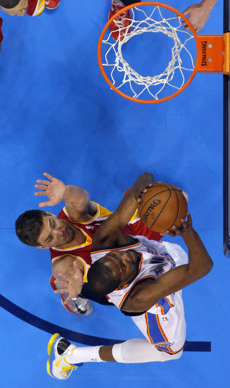 Oklahoma City's Kevin Durant (35) shoots a lay up over Houston's Chandler Parsons (25) during Game 5  in the first round of the NBA playoffs between the Oklahoma City Thunder and the Houston Rockets at Chesapeake Energy Arena in Oklahoma City, Wednesday, May 1, 2013. Photo by Sarah Phipps, The Oklahoman