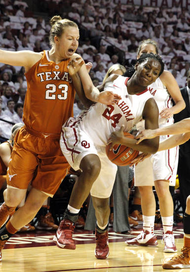 Oklahoma Sooners' Sharane Campbell (24) and Texas Longhorn's Gigi Mazionyte (23) colide as the University of Oklahoma Sooners (OU) play the University of Texas (UT) Longhorns in NCAA, women's college basketball at The Lloyd Noble Center on Saturday, Jan. 19, 2013 in Norman, Okla. Photo by Steve Sisney, The Oklahoman