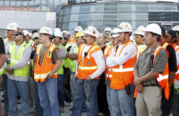 Construction workers are shown in this September 2011 photo of the Devon Energy Center toping-out ceremony. Photo by Paul B. Southerland, The Oklahoman &lt;strong&gt;PAUL B. SOUTHERLAND&lt;/strong&gt;