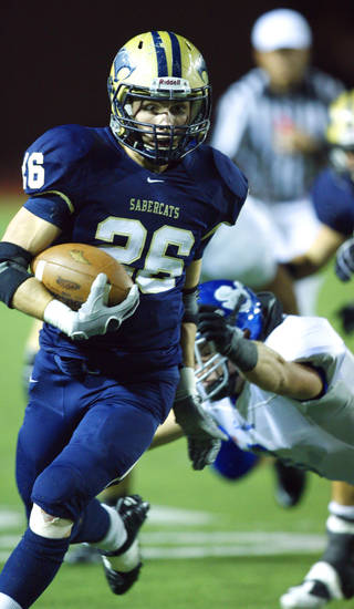 Southmoore's Andrew Long (26) carries against Sapulpa in high school football at Moore High School field on Thursday, Sept. 30, 2010, in Norman, Okla.  Photo by Steve Sisney, The Oklahoman
