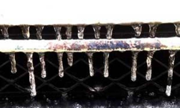 Icicles on the front grill of a vehicle in Midwest City Tuesday morning - Photo by Jim Beckel
