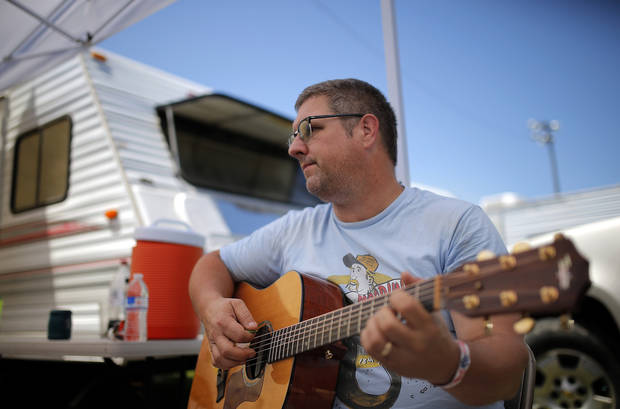 Adam Miller plays music at the campground during the Woody Guthrie Festival in Okemah, Okla., Friday, July 11, 2014. Photo by Sarah Phipps, The Oklahoman
