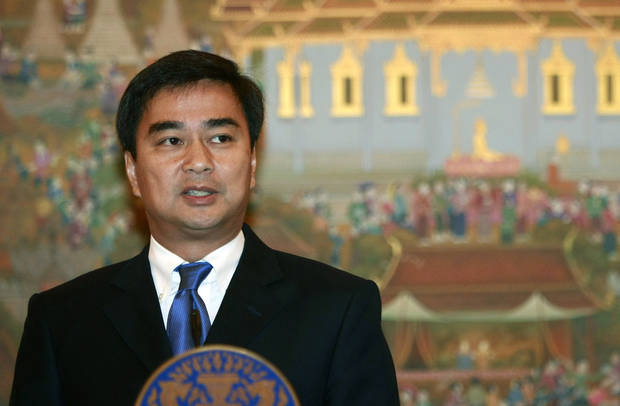 FILE - In this July 19, 2011 file photo, outgoing Thai Prime Minister Abhisit Vejjajiva talks to reporters during a news conference on Thailand&#039;s dispute with Cambodia over an ancient temple at Government House in Bangkok. Thai law enforcement authorities announced Thursday, Dec. 6, 2012, that they will file murder charges against Abhisit and his deputy in the first prosecutions of officials for their roles in a deadly 2010 crackdown on anti-government protests. (AP Photo/Apichart Weerawong, File)
