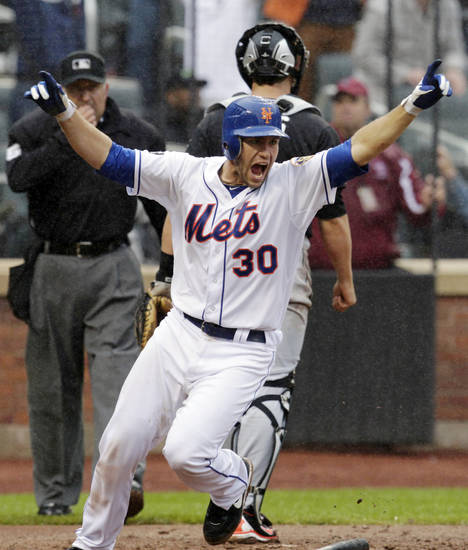 New York Mets' Josh Thole celebrates after scoring the winning run on a single hit by Kirk Nieuwenhuis during the ninth inning of a baseball game against the Miami Marlins, Thursday, April 26, 2012, at Citi Field in New York. The Mets won 3-2. (AP Photo/Seth Wenig)