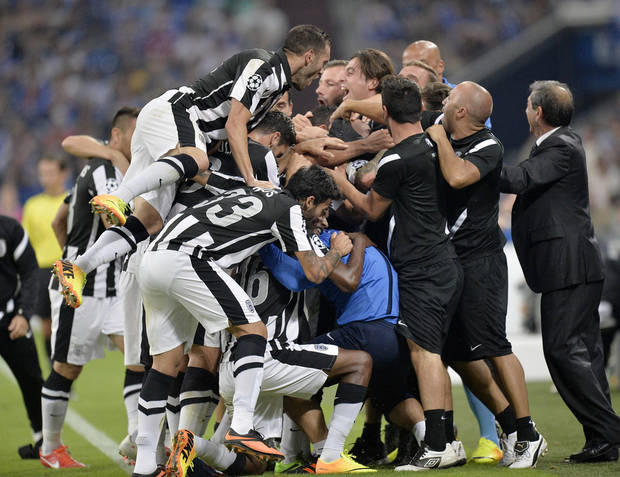 PAOK's Miroslav Stoch is celebrated in the crowd after scoring during the Champions League Qualification first leg soccer match between FC Schalke 04 and PAOK Saloniki in Gelsenkirchen, Germany, Wednesday, Aug. 21, 2013. (AP Photo/Martin Meissner)
