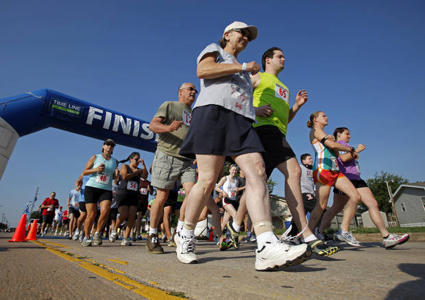 Runner start a 5K Run sponsored by the Cleveland County sheriff's office to raise money for Bridges on Saturday, June 9, 2012, in Norman, Okla.     Photo by Steve Sisney, The Oklahoman