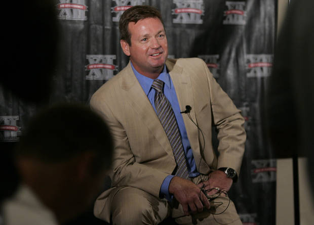 Oklahoma head football coach Bob Stoops talks with reporters at Big 12 media day in Irving, Texas, on Wednesday, July 28, 2010.  (AP Photo/Mike Fuentes) ORG XMIT: TXMF106