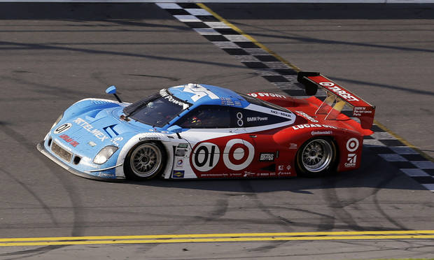 Ganassi Racing team driver Juan Pablo Montoya, of Colombia, crosses the finish line to win the Grand-Am Series Rolex 24 hour auto race at Daytona International Speedway, Sunday, Jan. 27, 2013, in Daytona Beach, Fla. (AP Photo/John Raoux)