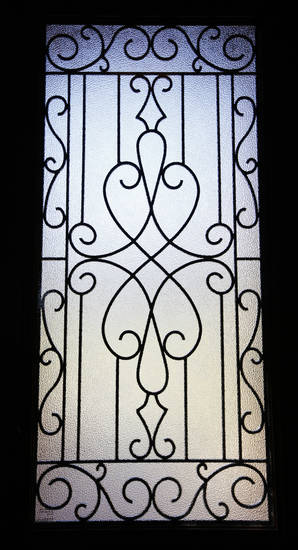 Daylight appears through a wrought iron-decorated door panel in a model home by SWM & Sons at 12005 Tuscany Ridge Road in Midwest City.  Photo by Paul B. Southerland, The Oklahoman <strong>PAUL B. SOUTHERLAND</strong>