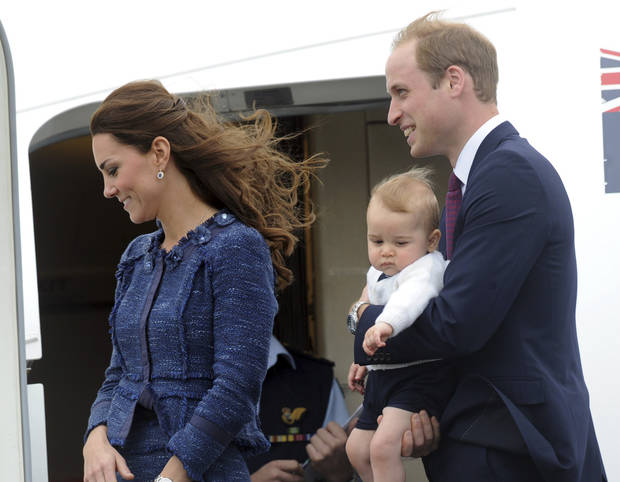 Britain's Prince William carries Prince George with Catherine, Duchess of Cambridge as they depart on an RAAF plane bound for Sydney, Wellington, New Zealand, Wednesday, April 16, 2014.  (AP Photo/SNPA, Ross Setford) **NEW ZEALAND OUT**