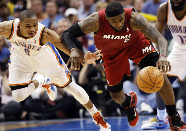 Miami's LeBron James (6) and Oklahoma City's Russell Westbrook (0) chase a loose ball during the NBA basketball game between the Miami Heat and the Oklahoma City Thunder at Chesapeake Energy Arena in Oklahoma City, Sunday, March 25, 2012. Oklahoma City won, 103-87. Photo by Nate Billings, The Oklahoman