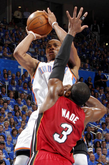 Oklahoma City's Russell Westbrook (0) shoots the ball over Miami's Dwyane Wade (3) during Game 1 of the NBA Finals between the Oklahoma City Thunder and the Miami Heat at Chesapeake Energy Arena in Oklahoma City, Tuesday, June 12, 2012. Photo by Chris Landsberger, The Oklahoman