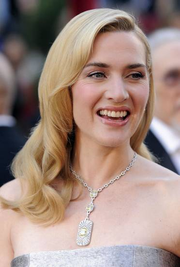 Actress Kate Winslet's retro waves have some lift and volume. The look can be achieved with hot rollers. Comb through, tease the hair a little, then set with hair spray. Note: This isn't the style for women with board straight hair. AP Photo. <strong></strong>