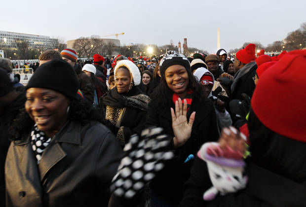 President Barack Obama supporters arrive on the National Mall in Washington, Monday, Jan. 21,  2013, for President Barack Obama's ceremonial swearing-in ceremony during the 57th Presidential Inauguration. (AP Photo/Jose Luis Magana)