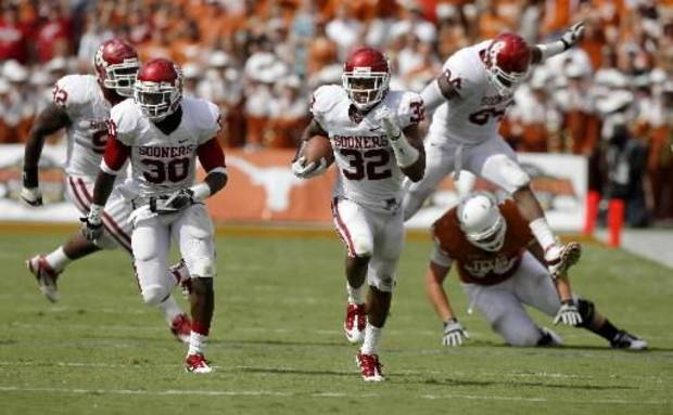 Oklahoma's Jamell Fleming (32) returns an a fumble for a touchdown beside Javon Harris (30) during the Red River Rivalry college football game between the University of Oklahoma Sooners (OU) and the University of Texas Longhorns (UT) at the Cotton Bowl in Dallas, Saturday, Oct. 8, 2011. Photo by Bryan Terry, The Oklahoman