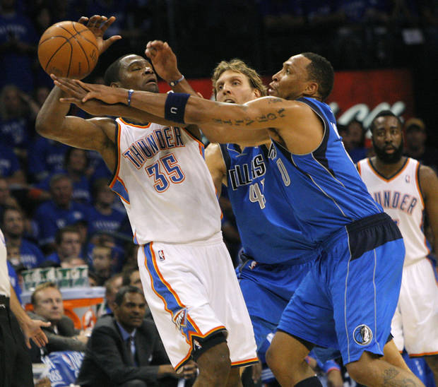 Oklahoma City's Kevin Durant (35) is defended by Dirk Nowitzki (41) and Shawn Marion (0) of Dallas  during game 4 of the Western Conference Finals in the NBA basketball playoffs between the Dallas Mavericks and the Oklahoma City Thunder at the Oklahoma City Arena in downtown Oklahoma City, Monday, May 23, 2011. Photo by John Clanton, The Oklahoman