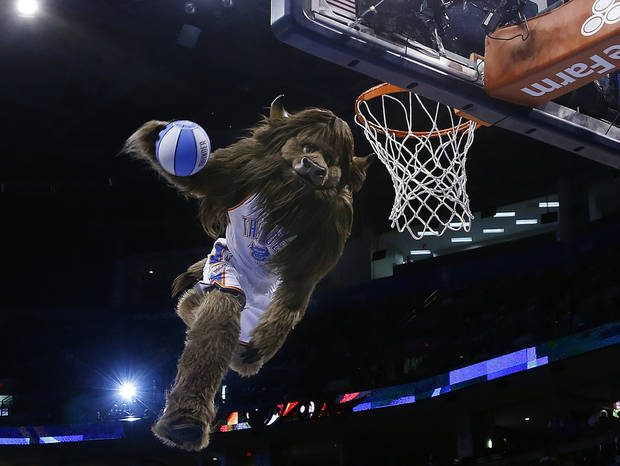 Rumble dunks the ball during the NBA preseason basketball game between the Oklahoma City Thunder and the Denver Nuggets at the Chesapeake Energy Arena, Sunday, Oct. 21, 2012. Photo by Sarah Phipps, The Oklahoman