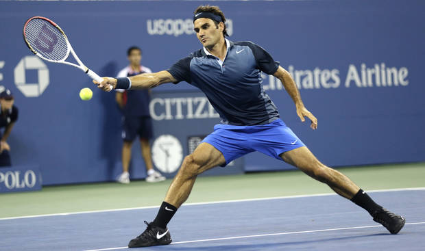Roger Federer, of Switzerland, returns against Adrian Mannarino, of France, during the second round of the 2013 U.S. Open tennis tournament, Saturday, Aug. 31, 2013, in New York. (AP Photo/Charles Krupa)