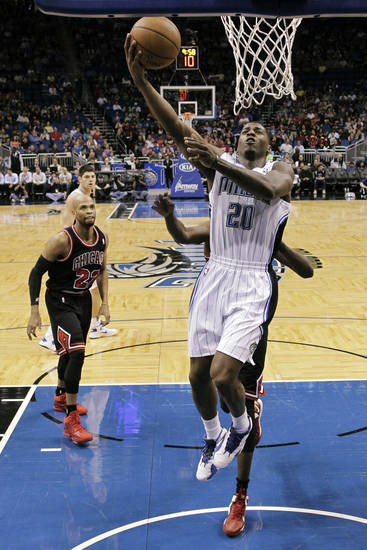 Orlando Magic's DeQuan Jones (20) shoots in front of Chicago Bulls' Taj Gibson (22) during the first half of an NBA basketball game, Wednesday, Jan. 2, 2013, in Orlando, Fla. (AP Photo/John Raoux)