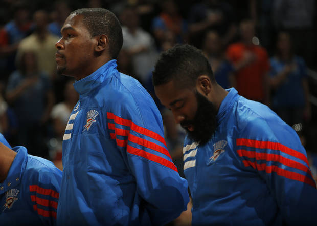 Oklahoma City's Kevin Durant (35) and James Harden (13) stand during the National Anthem before the preseason NBA game between the Oklahoma City Thunder and the Charlotte Bobcats at Chesapeake Energy Arena in Oklahoma City, Tuesday, Oct. 16, 2012. Photo by Sarah Phipps, The Oklahoman