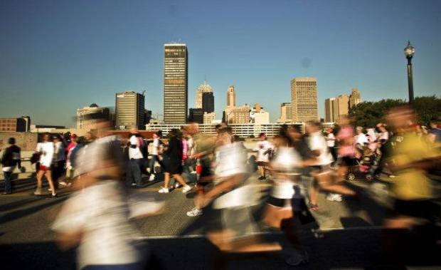 Runners are a blur as they pass the downtown skyline during the 2010 Susan G. Komen Central Oklahoma Race for the Cure in downtown Oklahoma City on Saturday, Oct. 9, 2010, in Oklahoma City, Okla.  Photo by Chris Landsberger, The Oklahoman ORG XMIT: KOD