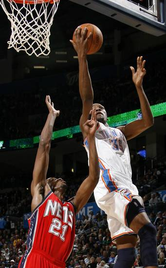 Oklahoma CIty&#039;s Kevin Durant goes to the basket past New Jersey&#039;s Travis Outlaw during the NBA basketball game between the Oklahoma City Thunder and the New Jersey Nets at the Oklahoma City Arena, Wednesday, Dec. 29, 2010.  Photo by Bryan Terry, The Oklahoman