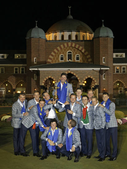 European team captain Jose Maria Olazabal is lifted for a team photo outside the clubhouse after the Ryder Cup PGA golf tournament Sunday, Sept. 30, 2012, at the Medinah Country Club in Medinah, Ill. (AP Photo/Chris Carlson)  ORG XMIT: PGA258