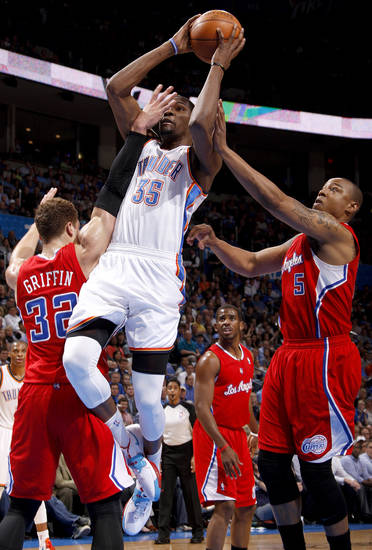 Oklahoma City's Kevin Durant (35) goes to the basket between Los Angeles' Blake Griffin (32) and Caron Butler (5) during the NBA basketball game between the Oklahoma City Thunder and the Los Angeles Clippers at Chesapeake Energy Arena in Oklahoma City, Wednesday, April 11, 2012. Photo by Bryan Terry, The Oklahoman